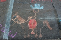 Muscatine Second Saturday: Horse and rider drawn with chalk