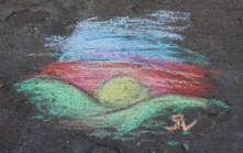 Muscatine Second Saturday: Chalk drawing of a sunset